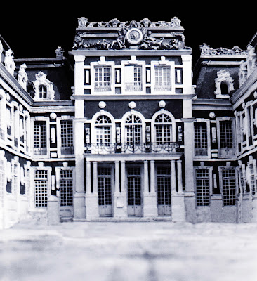 b/w image of Versailles 1/48 Palace Model with glazed windows, doors, roof decor, railings.