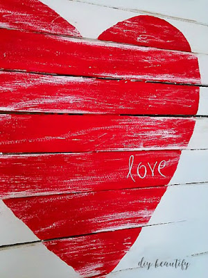 Make a mini pallet from wood shims, like this Valentines sign. Find the tutorial at diy beautify!
