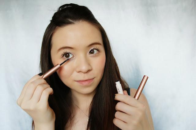 Girl applying glitter eyeliner