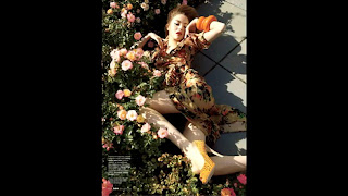 haute couture pose on flowers by model