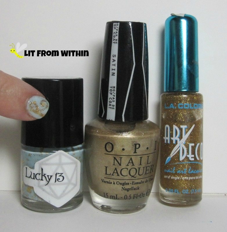 Bottle shot:   Lucky 13 Lacquer Softening The Bad Things, OPI Love.Angel.Music.Baby, and a gold glitter striper.
