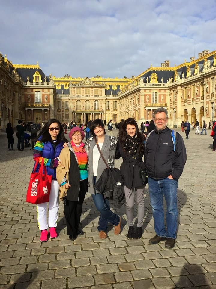 The group on the grounds of Palace of Versailles.
