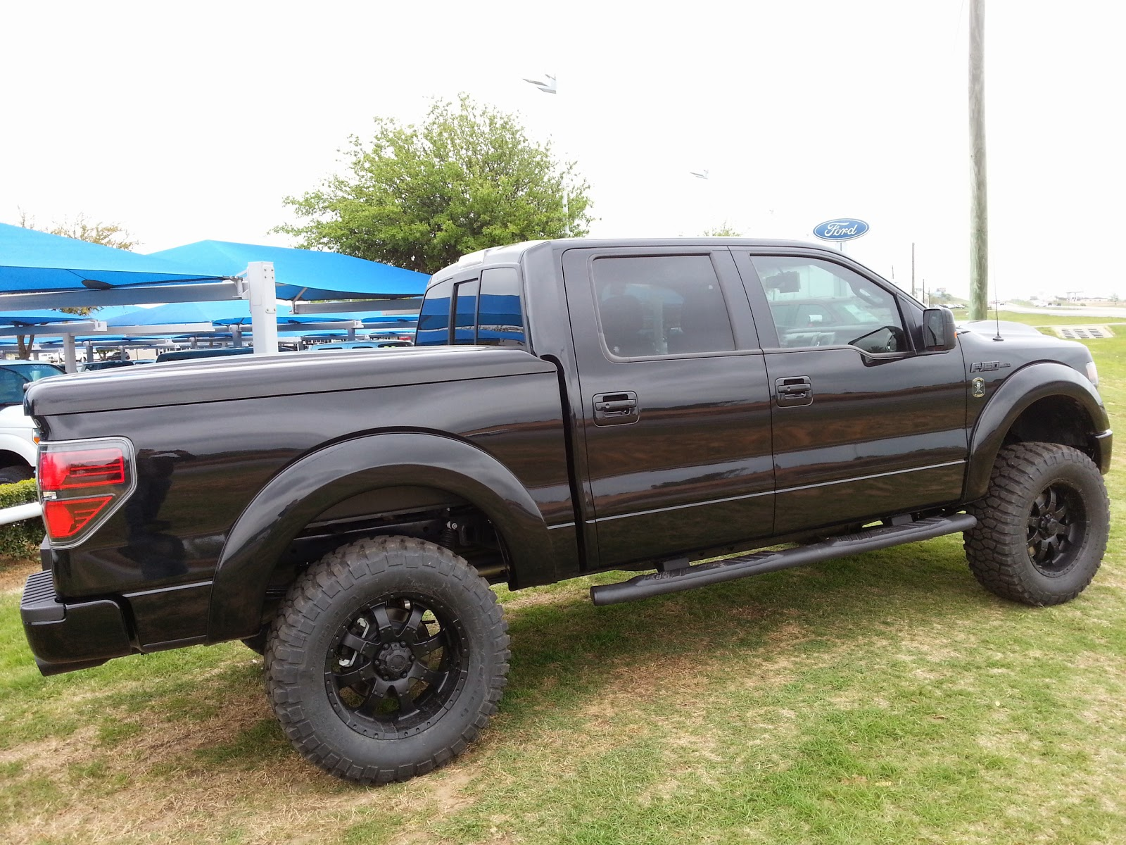 Tricked out new 2014 ford black ops edition 4x4 truck call troy young 817 243 9840