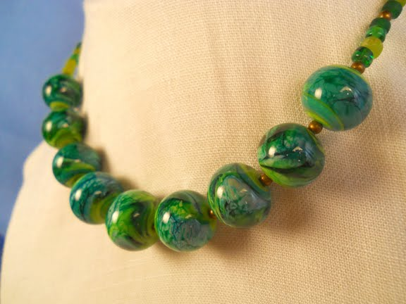 i make glass beads in my shop and design jewelry for sale at crafts shows in maine and here on etsy
