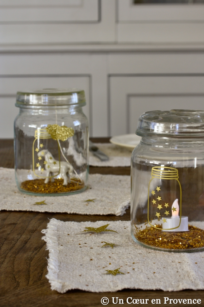 Christmas table with jars decorated with golden stickers
