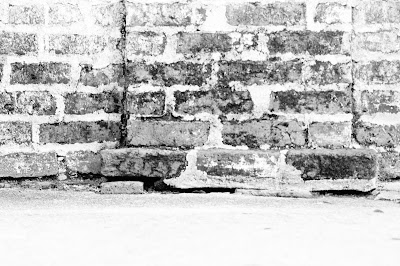 black and white picture of a brick wall