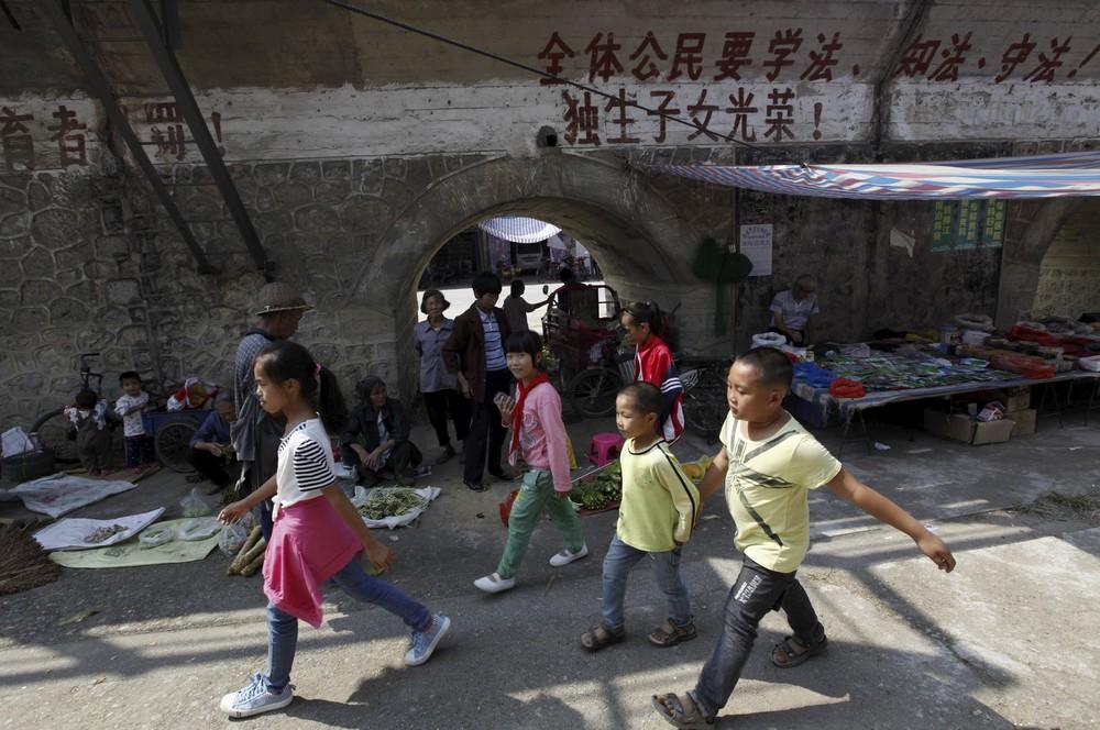 Кадры повседневной жизни в Китае (27 фото)