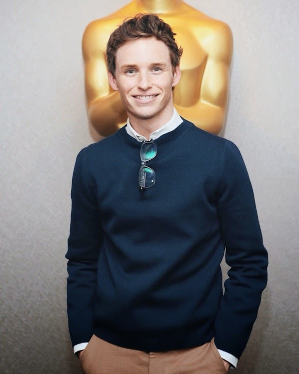 Eddie Redmayne wears Gucci Fall Winter 2014 navy knitwear and beige trousers to 'The Theory of Everything' Screening in NYC 21 October 2014