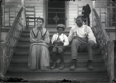 Members of the Shacklford family on their front porch