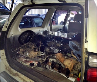 parts in back of car from engine overhaul