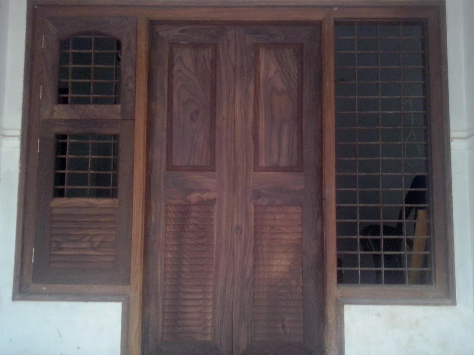 Wooden Double Door - Main entrance door design in Veetti wood