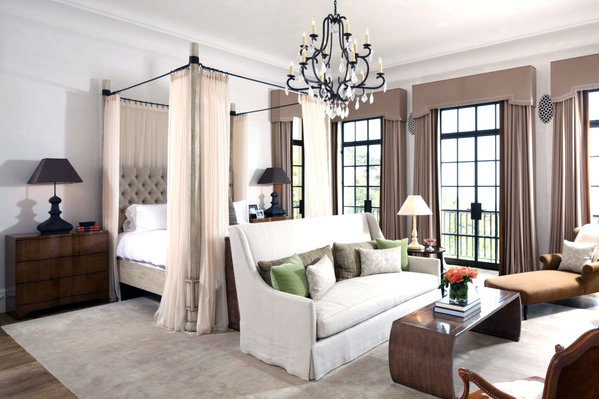 Bedroom with canopy bed and tufted headboard