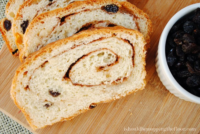 This Cinnamon Raisin Swirl Bread is filled with delicious buttery ribbons of cinnamon, sugar and California Raisins.   Makes three large loaves: perfect for freezing and gifting.