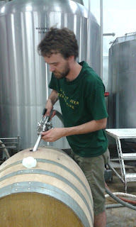 Filling the barrel with lambic wort