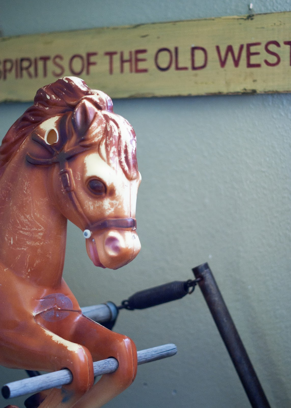 Vintage rocking horse and western sign