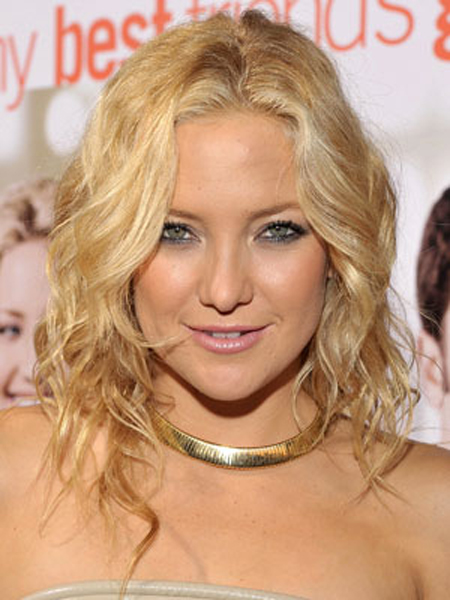 Kate Hudson's piecey waves are partially pulled back but totally sexy.