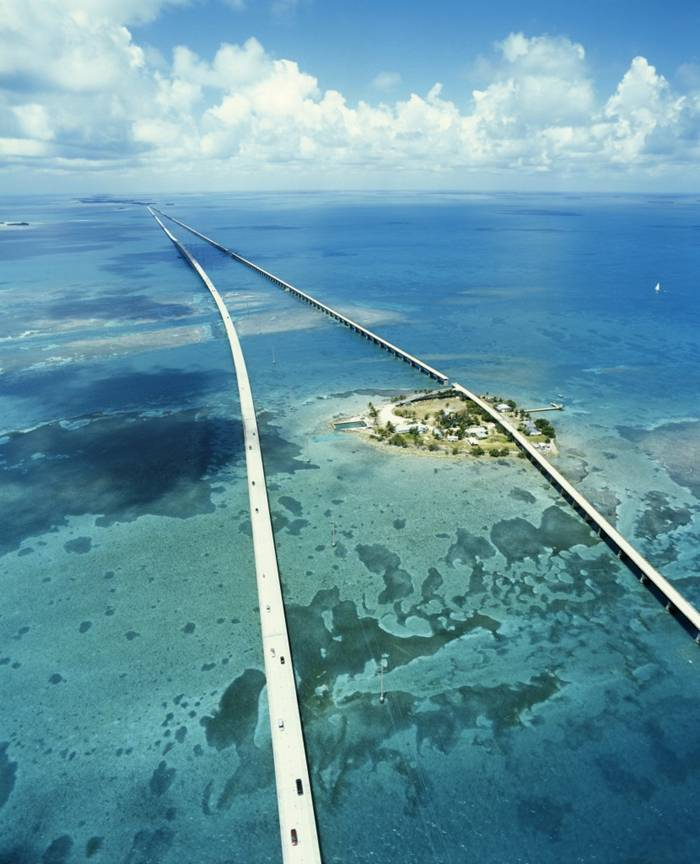 The Seven Mile Bridge is a famous bridge in the Florida Keys, in Monroe County, Florida, United States. It connects Knight's Key (part of the city of Marathon, Florida) in the Middle Keys to Little Duck Key in the Lower Keys. Among the longest bridges in existence when it was built, it is one of the many bridges on US 1 in the Keys, where the road is called the Overseas Highway.