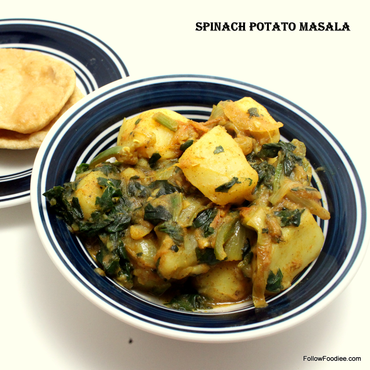 Spinach and potaotes cooked and tempered with spices