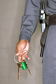 Correctional officer holding cell keys.