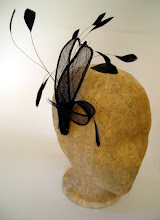 sinuous black sinamay leaves fascinator with shaved coq feathers