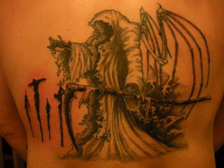 Death tattoo on the back: Grim Reaper with skeletal wings