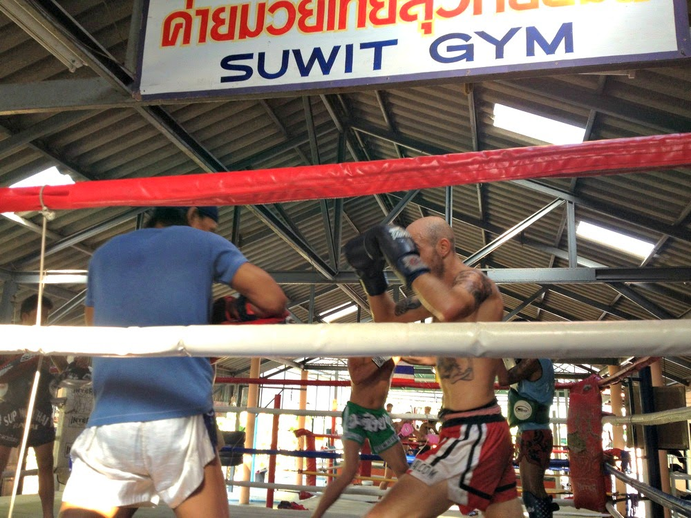 men in ring practicing Muay Thai martial art