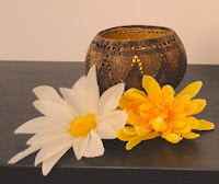 Lucinda Cracknell Massage - coconut shell candle holder and flowers