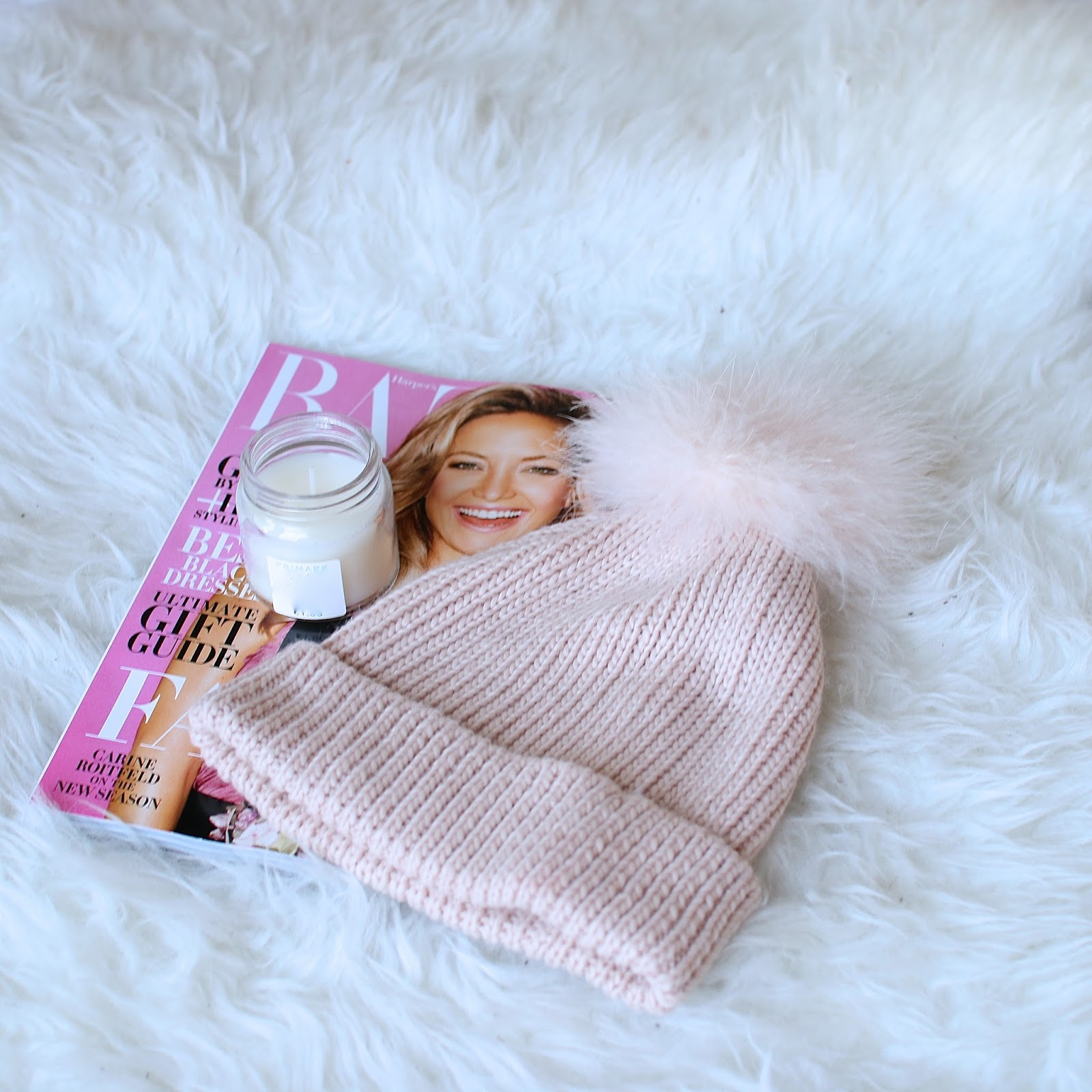 the cutest light pink fluffy pom pom toque from forever21