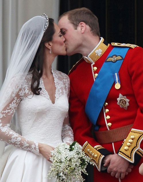 prince william and kate middleton kissing kate middleton fascinator hat. prince william kate middleton
