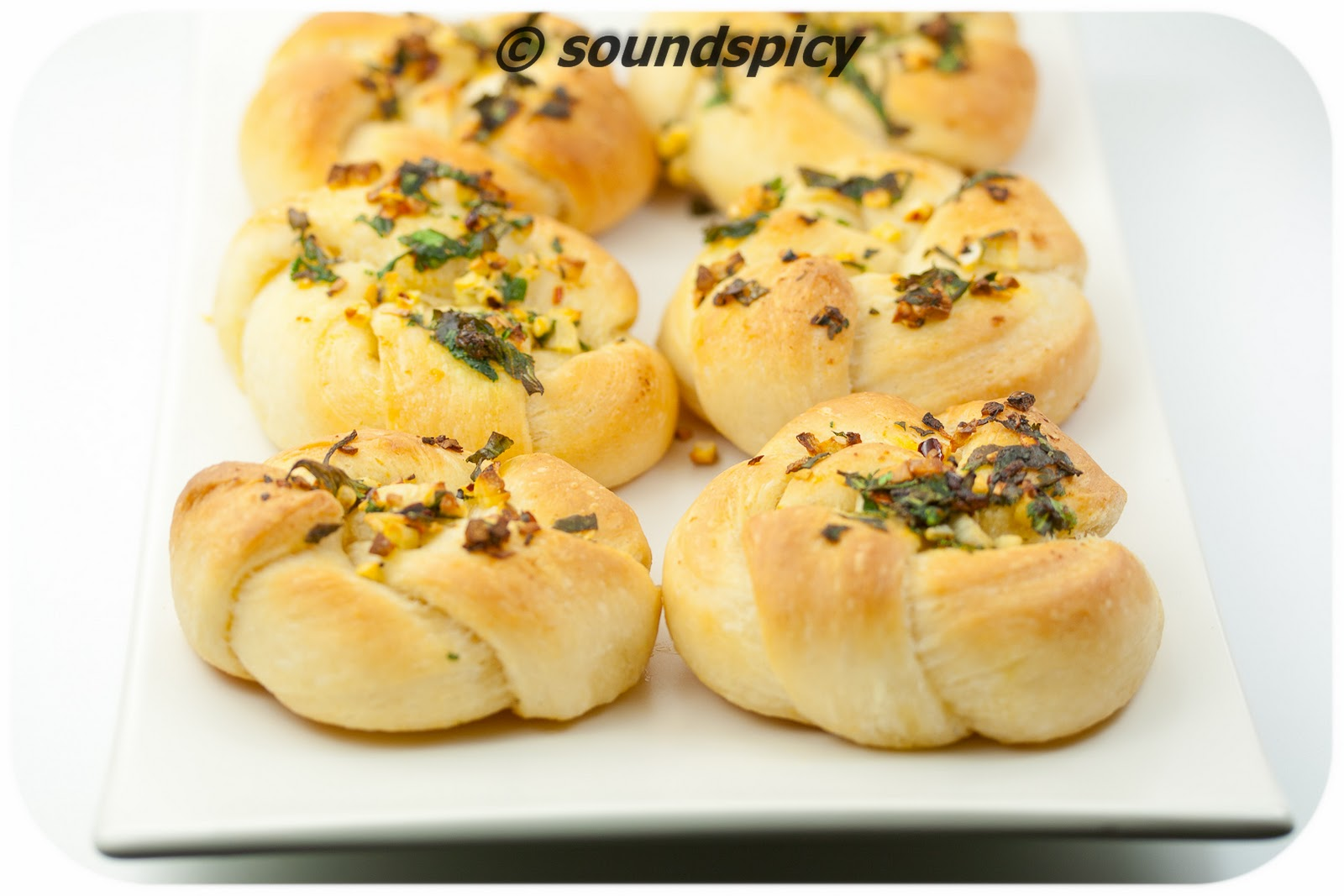 Garlic knots, flavored with fresh garlic and cilantro.