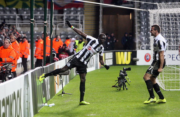 Papiss Cissé celebrates scoring against Anzhi Makhachkala by kicking an advertising hoarding