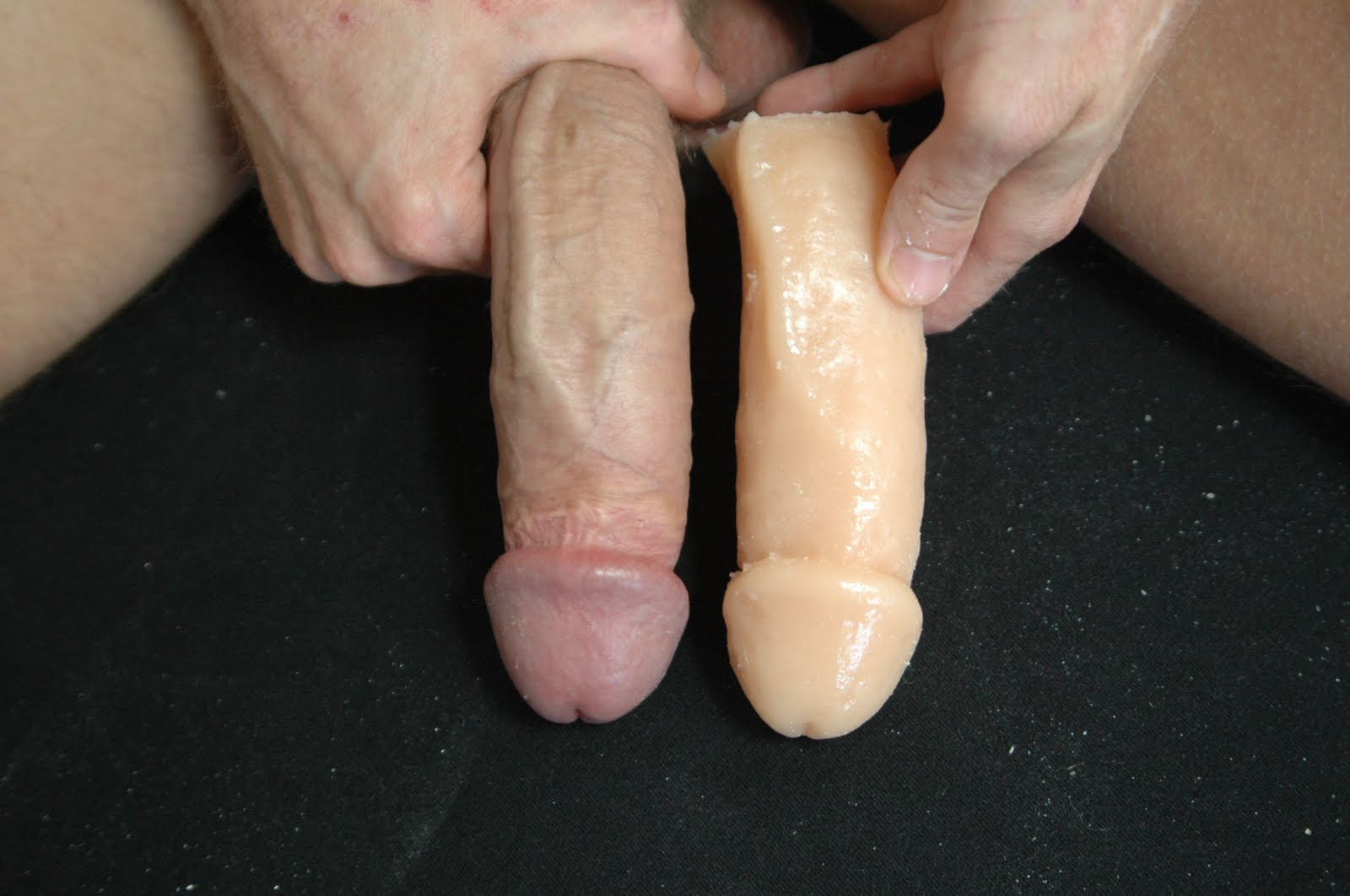 Stretching arse with two dildos to become wid