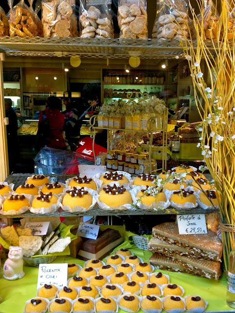 Image of polenta cakes in a shop window in Bergamo, Italy.