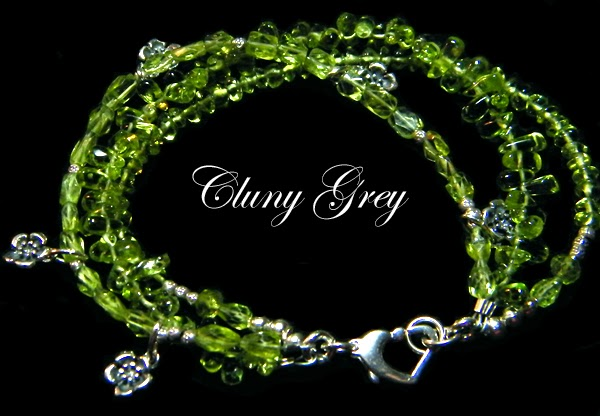 peridot bracelet with sterling charms