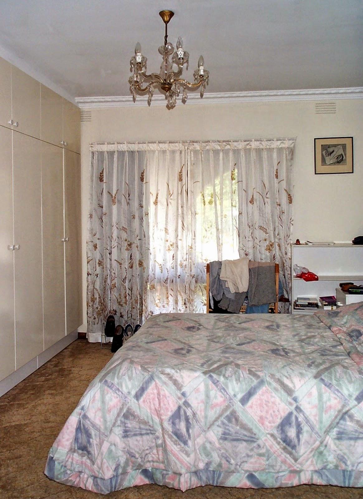 Floor-to-ceiling cupboards in main bedroom