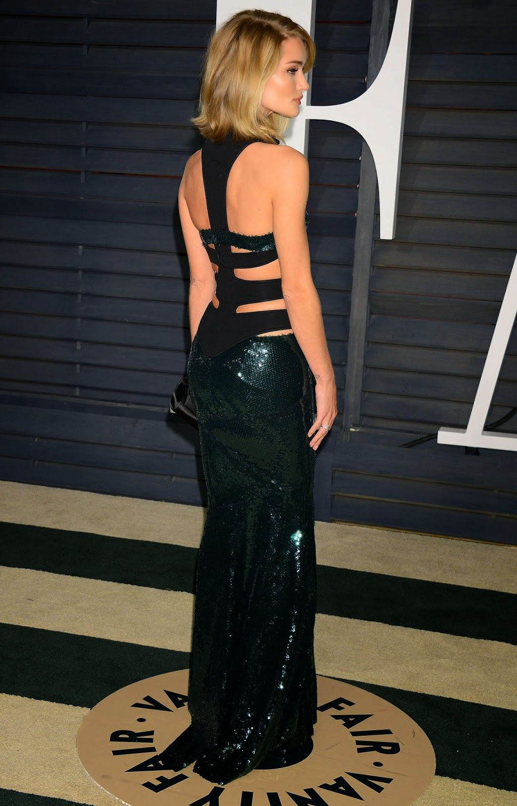 Rosie Huntington-Whiteley dazzles in a sequinned emerald dress at the 2015 Vanity Fair Oscars Party