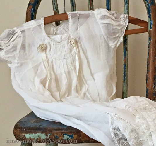 vintage christening gown worn blue chair