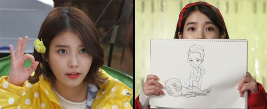 """IU as Kim Bo Tong flashes an """"OK"""" signal / holds up a drawing of Dok Go Ma Te being victorious."""