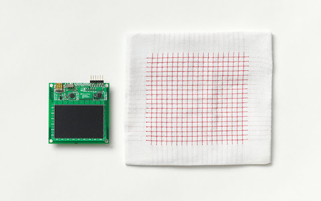 A digital chip next to a specially-designed piece of textile.