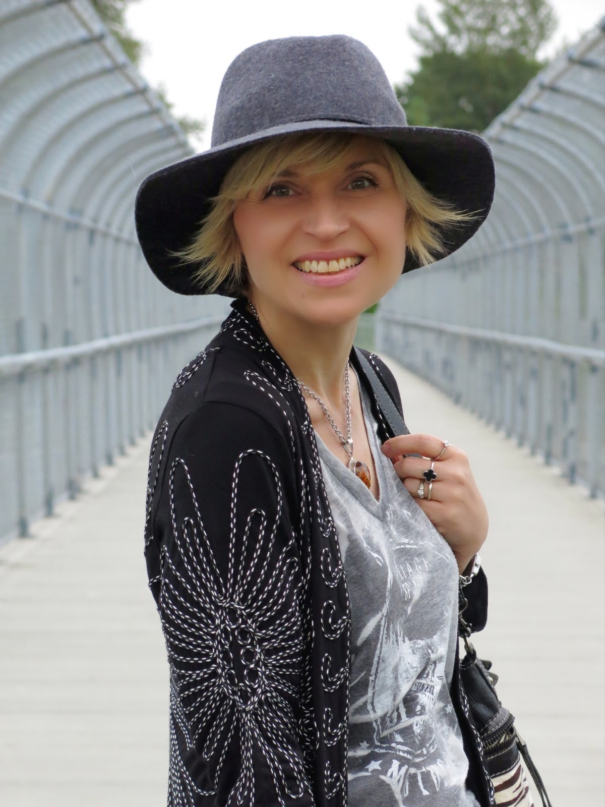 graphic tee, embroidered jacket, and floppy hat