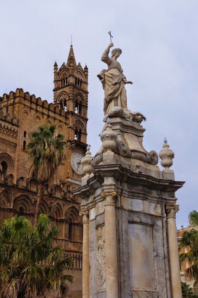 Stone statues outside a beautiful cathedral in Palermo Sicily Italy.