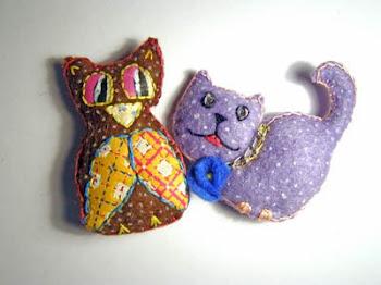 buho y gatito