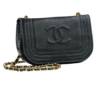 Vintage emerald green lizard skin Chanel bag with gold hardware and chain strap.