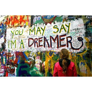 A photo of street grafitti that says, You may say I'm a dreamer, from the song Imagine by John Lennon