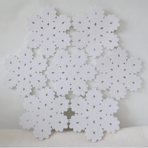 Felted snowflake table mats by Torie Jayne