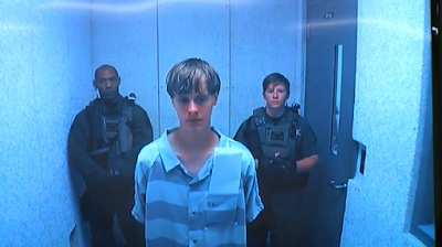 "Dylann Roof appears in court: A Washington Post writer argues against calling him a ""terrorist."""