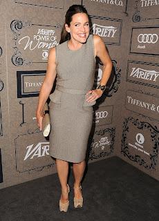Jennifer Garner strikes a pose in a grey dress