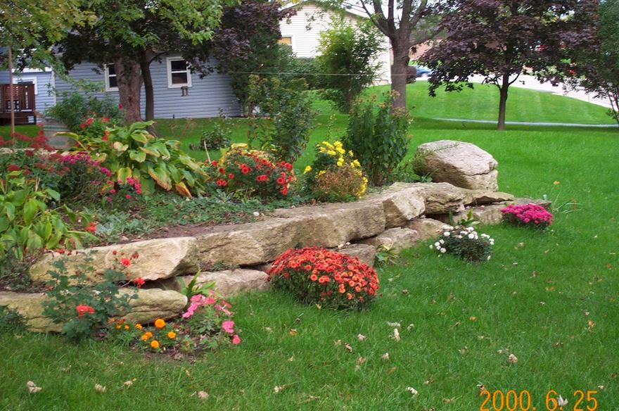 Reubens lawn care landscaping with rocks will spotlight for Landscaping your yard