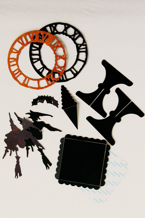 die cut two clocks two witches four bats two pennants and one cupcake stand and two base pieces i die cut the cupcake stand and base from sizzixs - Halloween Cupcake Holder