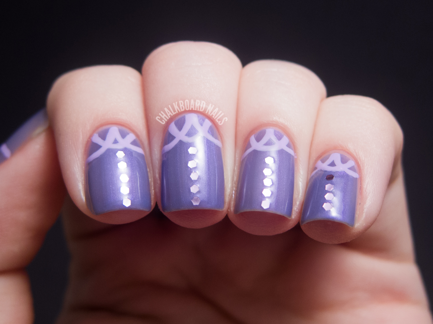 Light Purple Stiletto Nails Catch the light like inLight Purple Stiletto Nails